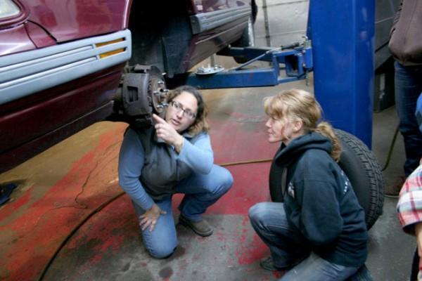 """Andrea Dello Russo (left) teaches """"Auto Mechanics for Women."""""""