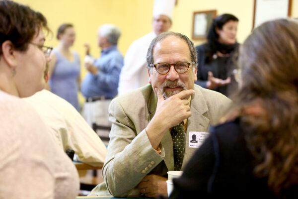 Paul Karasik, center engages with scholarship recipients at a recent scholarship reception.