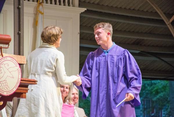 Jennifer Marlin congratulates a scholar.