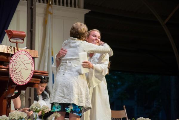 Jennifer Marlin congratulates a scholarship recipient.