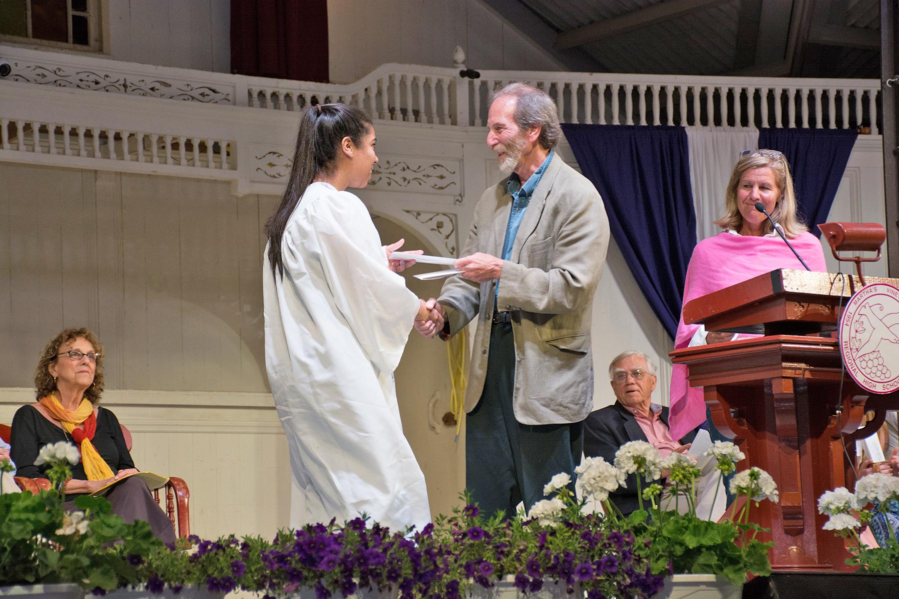 Jeff Rose congratulates a scholarship recipient.
